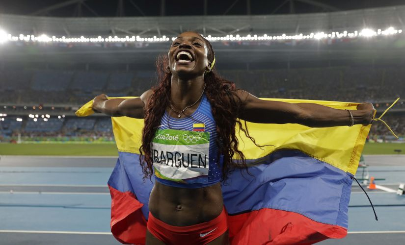 Caterine Ibarguen celebrates after winning the gold medal. AP