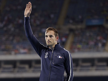France's silver medal winner Renaud Lavillenie waves during the medal ceremony for the men's pole vault final. AP