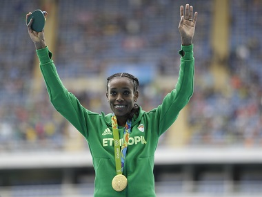 Ethiopia's Almaz Ayana celebrates winning the gold medal, adding to USA's medal tally, after the women's 10,000-meter final. AP
