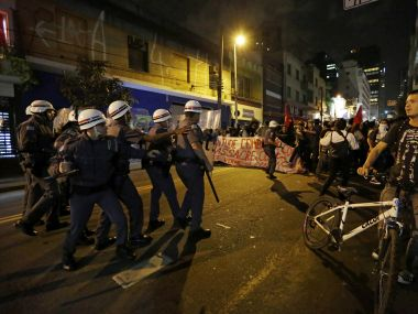 Police takes position as demonstrators march to protest against the money spent on the Rio's 2016 Summer Olympics and the interim Brazilian president Michel Temer. AP