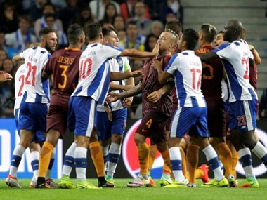 Porto and AS Roma players scuffle during their Champions League tie. Reuters