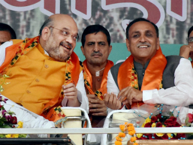 A file image of BJP president Amit Shah and Vijay Rupani. PTI