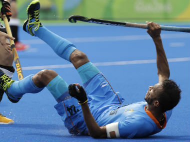 SV Sunil falls to the ground during the India-Germany Rio 2016 clash. AP