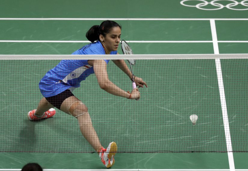 India's Saina Nehwal returns a shot against Brazil's Lohaynny Vicente during a women's badminton match at the 2016 Summer Olympics in Rio de Janeiro, Brazil, Thursday, Aug. 11, 2016. (AP Photo/Kin Cheung)