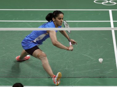 Saina Nehwal returns a shot against Lohaynny Vicente at Rio 2016. AP
