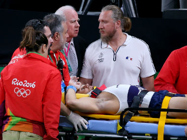French gymnast Samir Ait Said is attended to by the medical team present after suffering the horrific leg injury. Getty Images