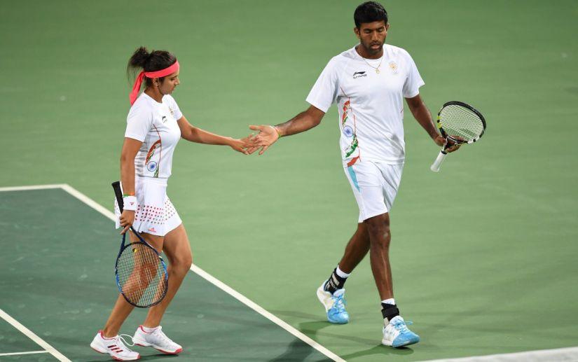 Sania Mirza and Rohan Bopanna react after winning a point at the Olympic Tennis Centre of the Rio Olympic Games. AFP