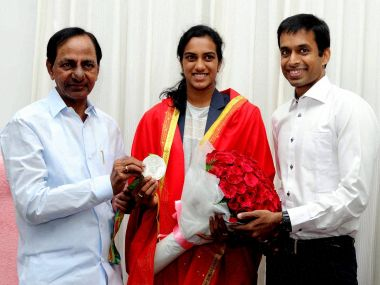 Telangana Chief Minister K Chandrasekhar Rao felicitates Olympic silver medalist shuttler PV Sindhu and coach Pullela Gopichand. PTI