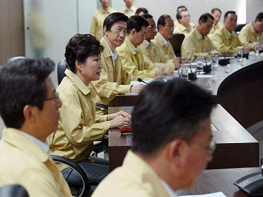 South Korean President Park Geun-hye. second from left, presides over a session of the National Security Council at the presidential house in Seoul, South Korea, Monday, Aug. 22, 2016. South Korea and the United States began annual military drills Monday despite North Korea's threat of nuclear strikes in response to the exercises that it calls an invasion rehearsal. (Baek Seung-ryul/Yonhap via AP)