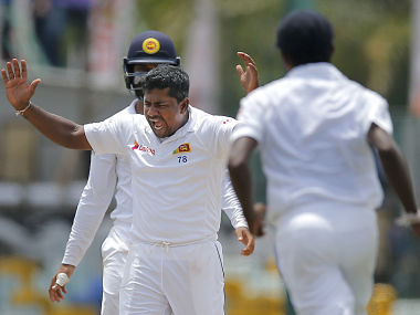 Sri Lanka's Rangana Herath celebrates after taking the wicket of Australia's Adam Voges. AP