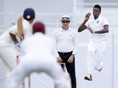 West Indies' Alzarri Joseph bowls to India's Ajinkya Rahane during day one of their third cricket Test match at the Daren Sammy Cricket Ground in Gros Islet, St. Lucia, Tuesday, Aug. 9, 2016. (AP Photo/Ricardo Mazalan)