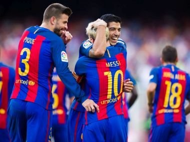 Luis Suarez celebrates with Lionel Messi during Barcelona's match against Real Betis. Getty
