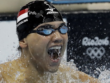 Singapore's Joseph Schooling celebrates after winning the gold in the men's 100-metre butterfly final. AP