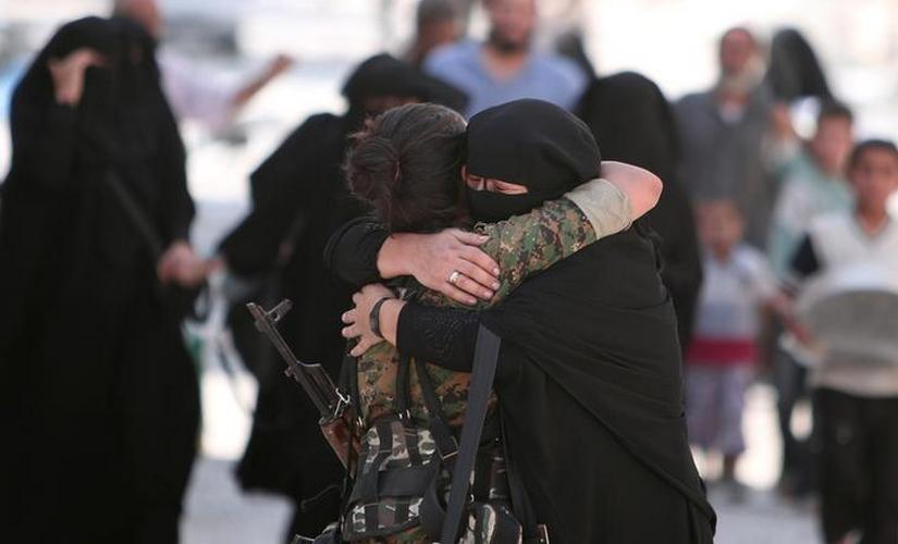 A woman embraces a Syria Democratic Forces (SDF) fighter after she was evacuated with others by the SDF from an Islamic State-controlled area in Aleppo Governorate, Syria. Reuters