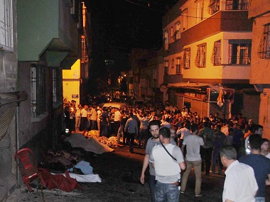 People gather after an explosion in Gaziantep, Turkey killed 51 of a wedding party. AP