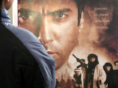 A Turkish man looks at a poster of the film 'Valley of Wolves - Iraq'. Reuters