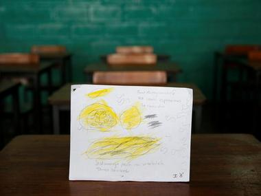 "A drawing made during a lesson at a school shows what a student ate during the course of a day in Caracas, Venezuela. The student wrote, ""Today I ate nothing for breakfast and had pasta with Mortadella for lunch. I'm hungry."" Reuters"