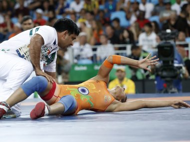 Vinesh Vinesh is treated after she was injured during the women's wrestling 48kg freestyle quarter-final. AFP
