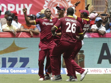 West Indies' players celebrate the win over India. AP