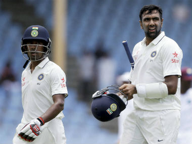 Wriddhiman Saha (left) and Ravichandran Ashwin. PTI