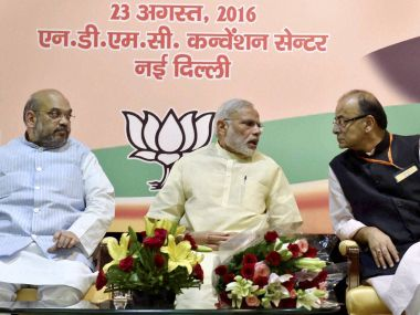 Prime Minister Narendra Modi with BJP president Amit Shah and Finance Minister Arun Jaitley at the concluding session of party's core committee meeting of all state units in New Delhi on Tuesday. PTI