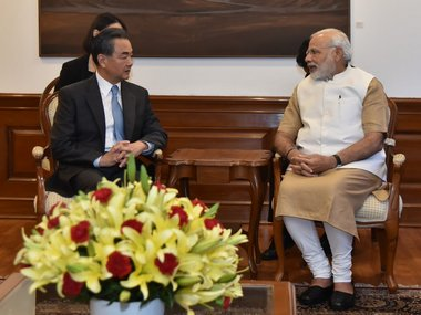 Prime Minister Narendra Modi meets Chinese Foreign Minister Wang Yi. Twitter/ @MEAIndia