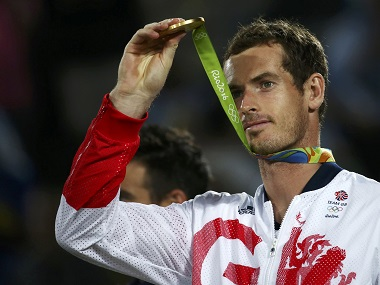 Gold medalist Andy Murray of Britain reacts after receiving his medal and adding to Britain's medal tally. Reuters