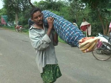 Image of the man carrying his wife's dead body.
