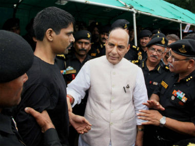 Union minister Rajnath Singh with NSG commandos. PTI