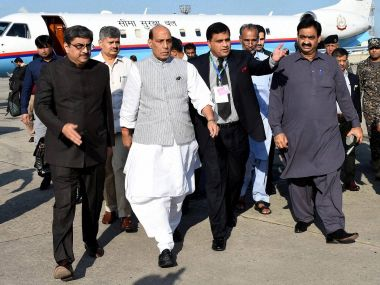 Pakistani officials escort Home Minister Rajnath Singh in Islamabad on Wednesday. AP/PTI