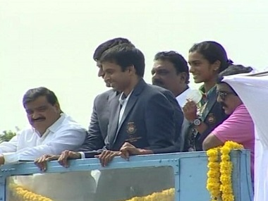 PV Sindhu on an open double-decker bus with her coach Pullela Gopichand