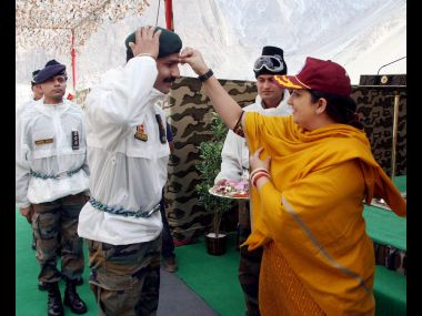 "Textiles Minister Smriti Irani celebrates Raksha Bhandan"" with Army jawans at Siachen base camp. PTI"