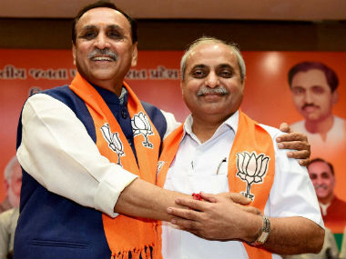 File image of Vijay Rupani and Nitin Patel. PTI