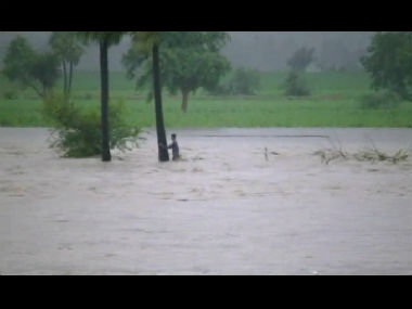 A 14-year-old boy survived the Andhra floods by hanging on to a tree for 8 hours. Screenshot from video