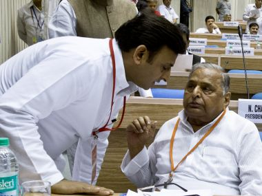 Uttar Pradesh CM Akhilesh Yadav (left) with father Mulayam Singh Yadav. AFP