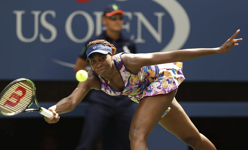 Venus Williams returns a shot to Karolina Pliskova during the fourth round of the US Open. AP