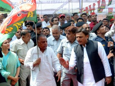 Samajwadi Party supremo Mulayam Singh Yadav and UP Chief Minister Akhilesh Yadav flagging off the Mulayam Sandesh Yatra at the party office in Lucknow on Saturday. PTI
