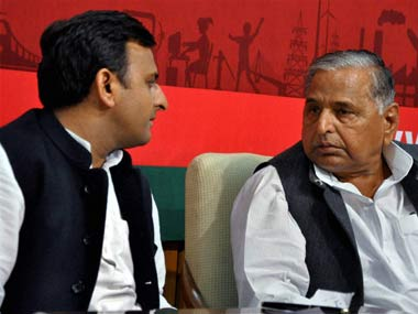 CM Akhilesh Singh Yadav (left) with father Mulayam. PTI