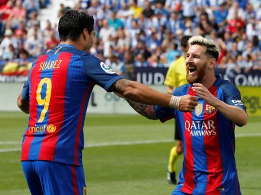 Barcelona's Lionel Messi celebrates goal with teammate Luis Suarez. Reuters