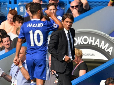 Chelsea coach Antonio Conte with midfielder Eden Hazard. AFP