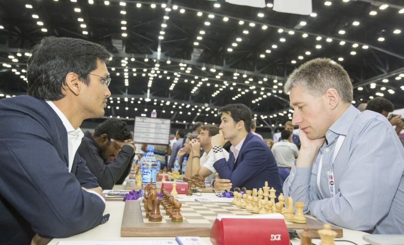 India facing England, with Harikrishna (Left Extreme) and Baskaran Adhiban pitted against Michael Adams (Rigth extreme) and David Howell. Image Credit: V Saravan/Firstpost