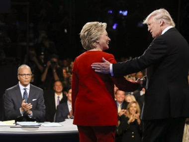 Democratic presidential nominee Hillary Clinton and Republican presidential nominee Donald Trump shake hands during the presidential debate at Hofstra University. AP
