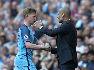 Kevin De Bruyne and Pep Guardiola. Reuters