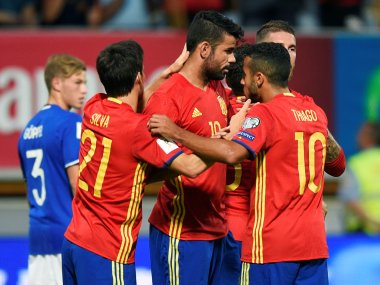 Spain's Diego Costa celebrates his goal with teammates. Reuters
