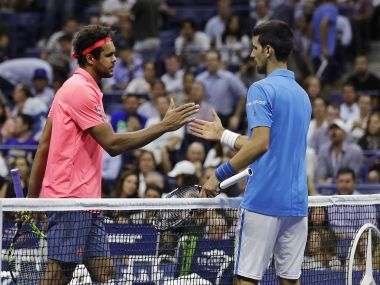 Jo-Wilfried Tsonga shakes hands with Novak Djokovic after Tsonga retired. AP