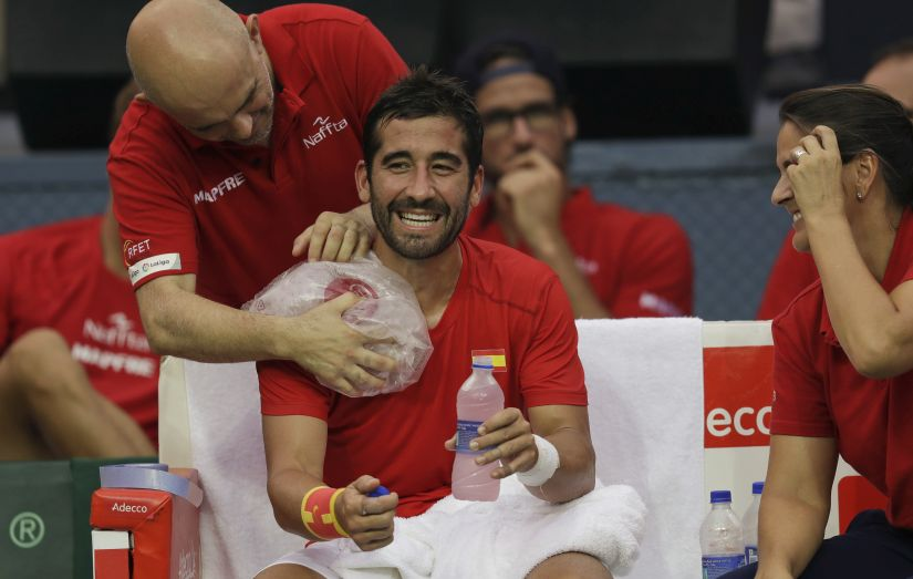 Spain's Marc Lopez reacts during a break during his Davis Cup men's tie. AP