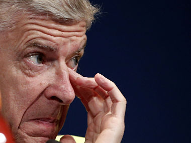Arsenal head coach Arsene Wenger attends a press conference ahead of Arsenal's match against PSG. AP