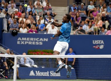 Gael Monfils returns the ball against Lucas Pouille during their US Open quarter-final. AFP