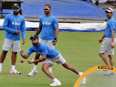 Virat Kohli and other Indian players during a training session at Eden Gardens. PTI