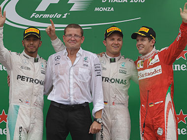 Lewis Hamilton, Mercedes chief designer John Owen, Nico Rosberg and Sebastian Vettel on the Monza podium. AP